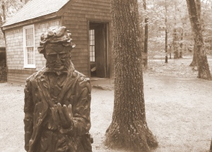 Statue of Thoreau and replica of his cabin